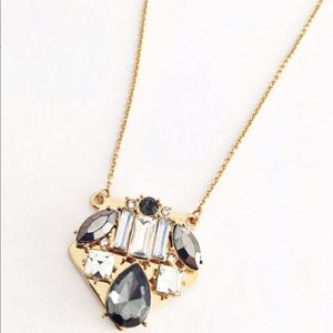 Express gold gray pendant shield necklace